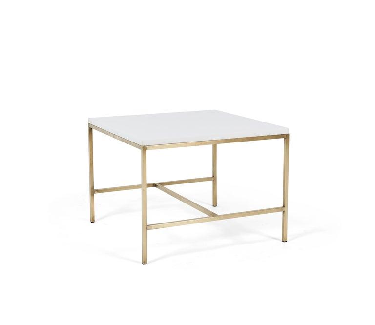 Paul McCobb brass frame side table with white vitrolite glass top.
