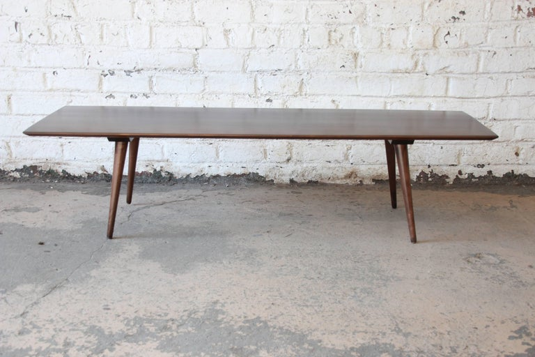 Offering a very nice newly refinish dark brown Paul McCobb Planner Group coffee table by Winchendon Furniture. The table has clean midcentury lines and is made from solid birch. A great example of McCobb's sleek clean designs. The table is newly