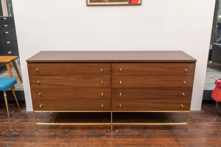 Paul McCobb design mahogany and brass double dresser for Calvin Group Irwin collection.