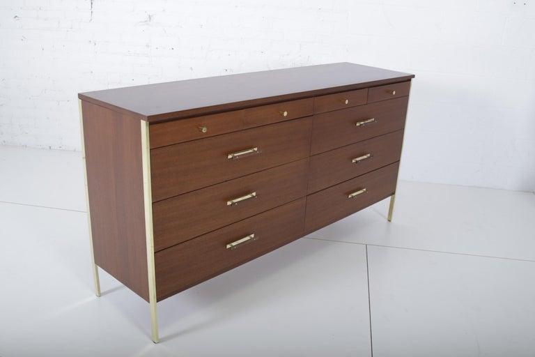 Paul McCobb dresser for Calvin Furniture, circa 1950s. Dresser has brass trim and brass hardware.