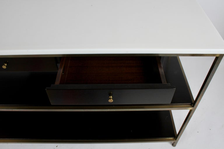 Mid-20th Century Paul McCobb for Calvin Console Table with White Vitrolite Top and Brass Frame For Sale
