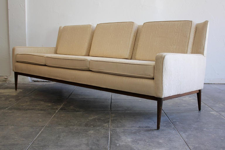 Elegant modern design 3-seat wingback sofa designed by Paul McCobb for Directional, circa 1950s. This has been intentionally left in as-found condition. Upholstery is in good condition and can be used as-is. Minor wear from use as pictured. Light
