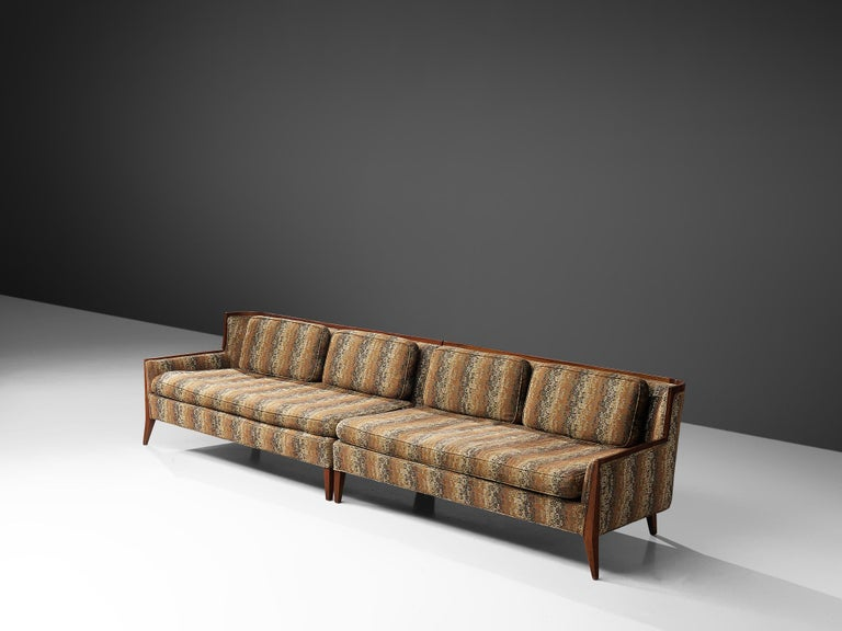Paul McCobb for Directional, sectional sofa, fabric and walnut, United States, 1950s  A large sectional sofa, consisting of two elements designed by Paul McCobb for Directional. The sofa shows is similar to the '407' model, which was produced in