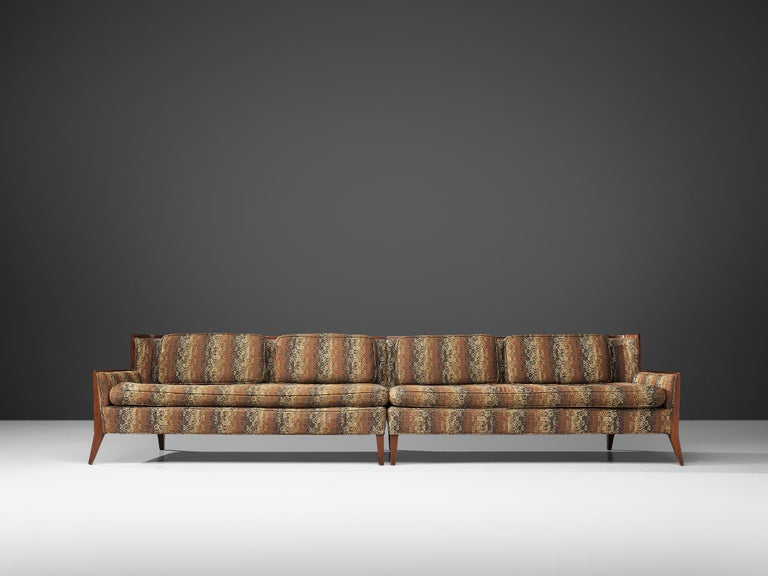 Paul McCobb for Directional, sectional sofa, patterned upholstery, walnut, United States, 1950s  A large sectional sofa, consisting of two elements designed by Paul McCobb for Directional. The two parts can either be placed next to each other and