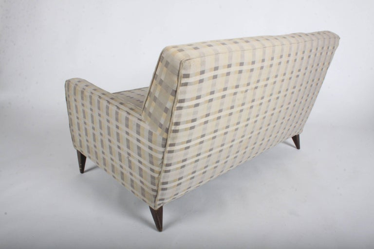 Paul McCobb for Planner Group loveseat, settee or sofa. Upholstery needs to be updated as it has stains, foam is good. Price includes refinishing of legs. Measures: Seat 16