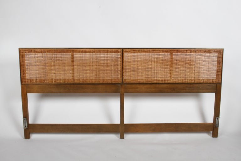 Paul McCobb king size headboard for Calvin with caned panels. Aluminum edge, mahogany frame and caned panels. Caning has a few losses, will be professionally repaired, and light restoration / clean up to wood prior to shipping. Slight scuffs to