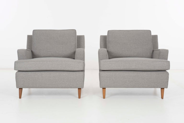 McCobb for Planer Group, pair of rare lounge chairs. Birchwood spayed legs, reupholstered with great plains wool blend, back pillows are down filled.
