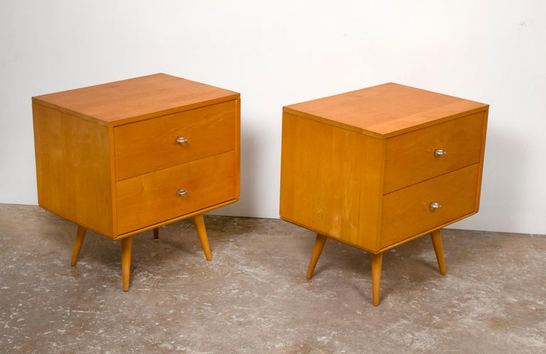 Stunning pair of solid maple Paul McCobb nightstands with original hardware. These cabinets are rock solid and were lightly refreshed. Ultra-modern and indestructible.