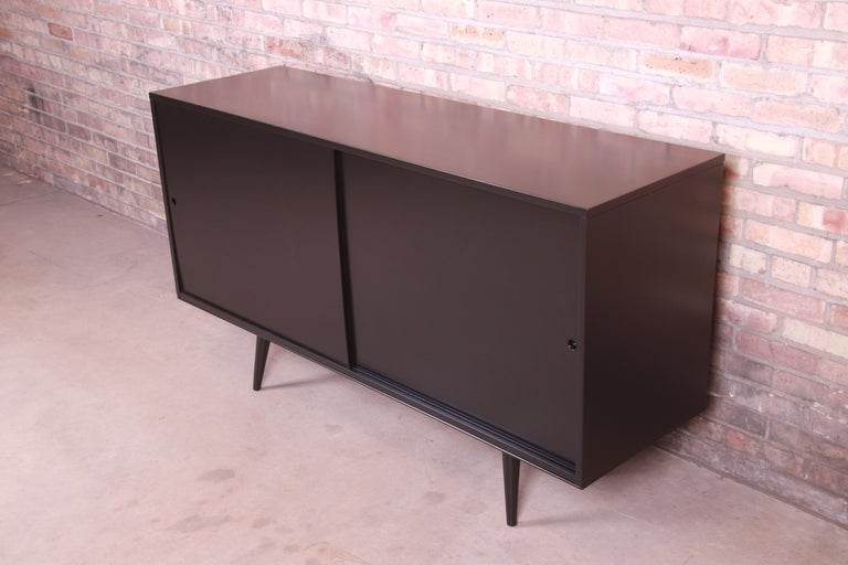 An exceptional Minimalist Mid-Century Modern sliding door sideboard, credenza, or bar cabinet  By Paul McCobb for Winchendon Furniture