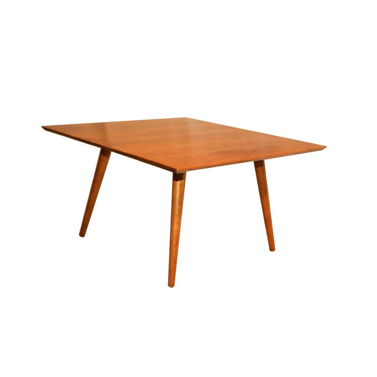 Original, handsome, Classic, midcentury coffee table designed by Paul McCobb for the Planner Group collection. Square table in maple with gently tapered legs and a slender profile. The top has the appearance of floating. Solid maple construction.