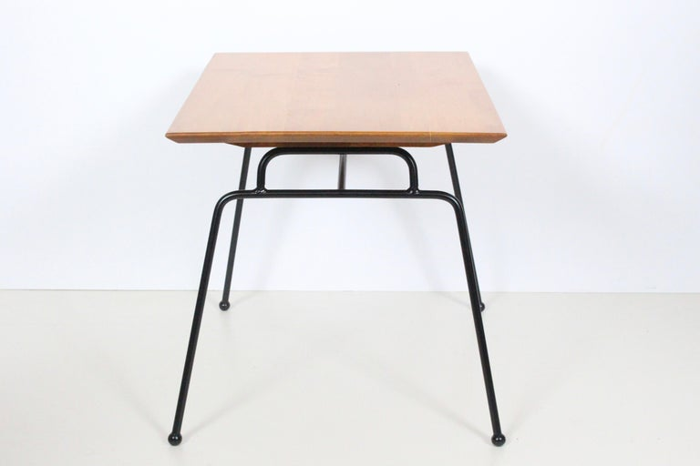 Early Paul McCobb Planner Group Winchendon Model 124 iron and birch coffee table., nightstand, side table. Featuring 1/2 inch iron rod framework, solid staved North American Birch, refinished in natural finish and detailed with ball feet. With paper