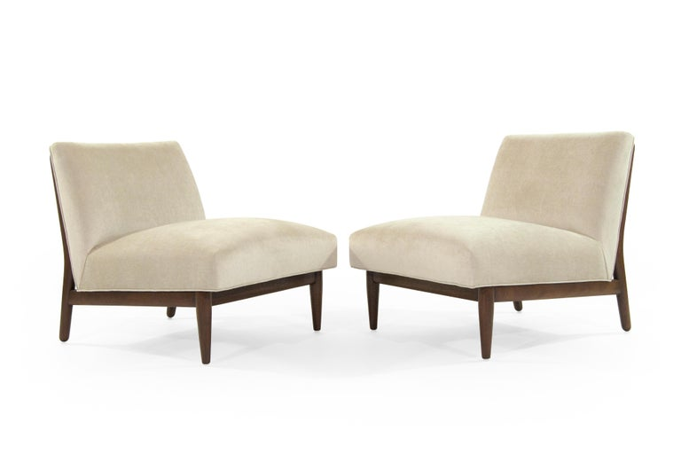 A rare set of brass accented, mahogany slipper chairs designed by Paul McCobb (slide to last picture for advertisement by Better Homes & Gardens, circa 1950s).  Newly upholstered in Holly Hunt Velvet, mahogany frames fully restored.