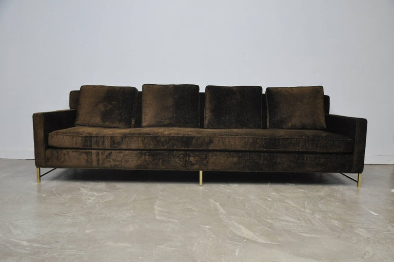 Sofa by Paul McCobb for Directional Furniture. Fully restored and reupholstered in Great Plaines textured velvet over polished brass stretcher bases.