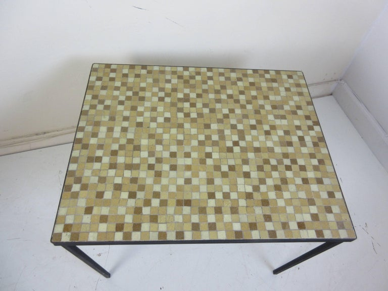 Paul McCobb tile top wrought iron side or lamp table with glass tiles in shades of tan, off-white and brown.