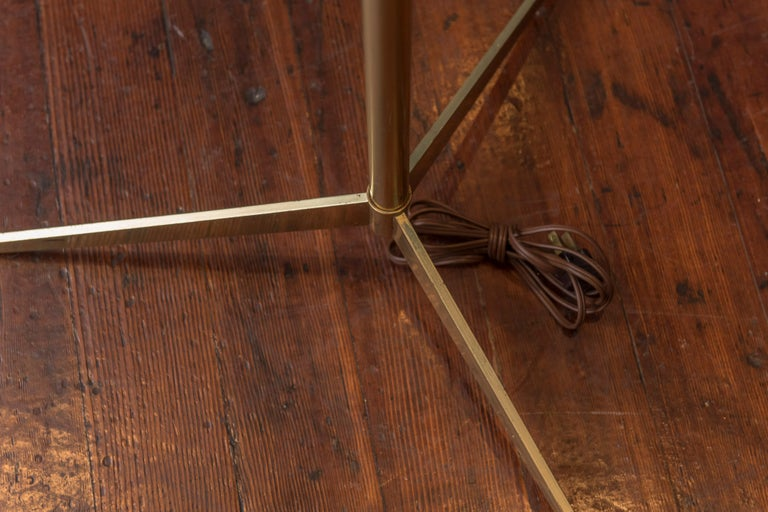 Paul McCobb brass tripod base floor lamp. Very good condition with updated sockets and wiring.