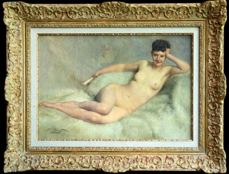A wonderfully painted oil on canvas circa 1920 by French painter Paul Sieffert depicting a beautiful laid on white fur holding a fan. This work is numbered 426 in the oeuvre of Paul Sieffert and is designated verso in the artist's hand. Signed lower