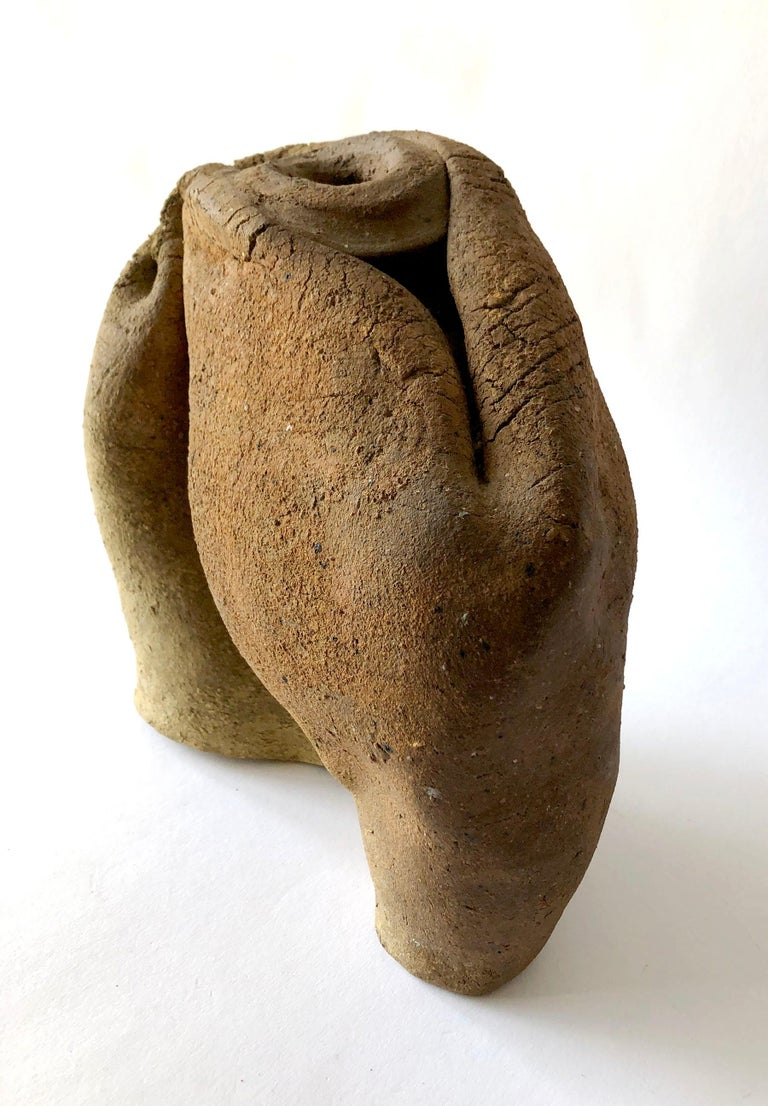 California studio folded pottery vase vessel created by listed sculptor and ceramist, Philip Cornelius of Pasadena, California. Piece measures 9.5