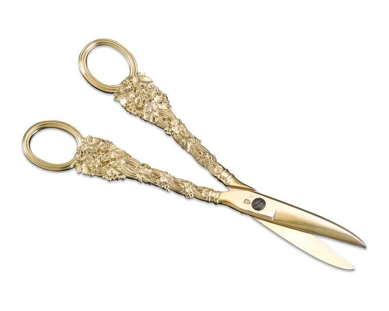 An incredibly rare and exceptional pair of grape shears by Paul Storr, one of the most esteemed silversmiths in history. With handles laden with grapevines, this pair of intricate silver-gilt shears is an uncommon item in Storr's extraordinary