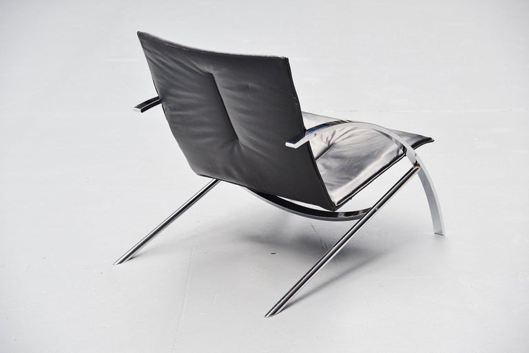 Fantastic dynamic lounge chair model Arco designed by Paul Tuttle for Strassle International, Switzerland 1976. Super heavy quality lounge chair in heavy solid chrome plated metal and high quality black leather upholstery. Very nice low lounge chair
