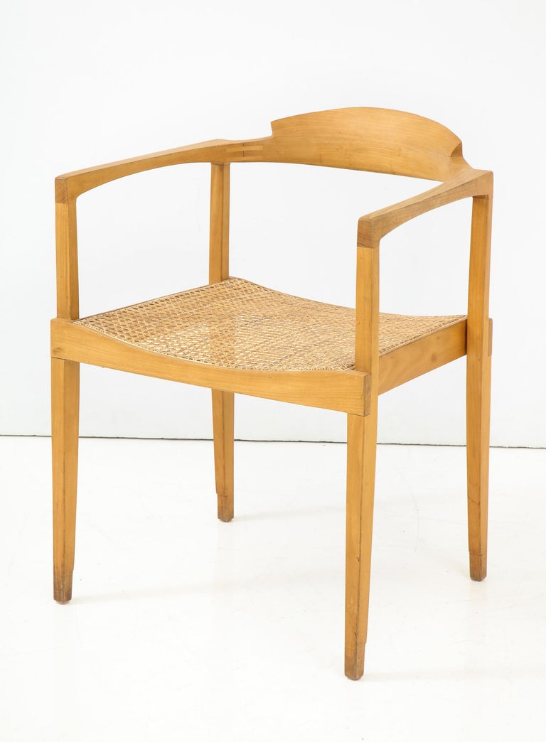 Elegant, rakish and well-crafted armchair by California designer Paul Tuttle. Fabricated in small numbers by Stanley Reifel of Carpenteria, CA, circa 1966. This example was part of a set made for Mrs. Esther Bear and was illustrated in solo