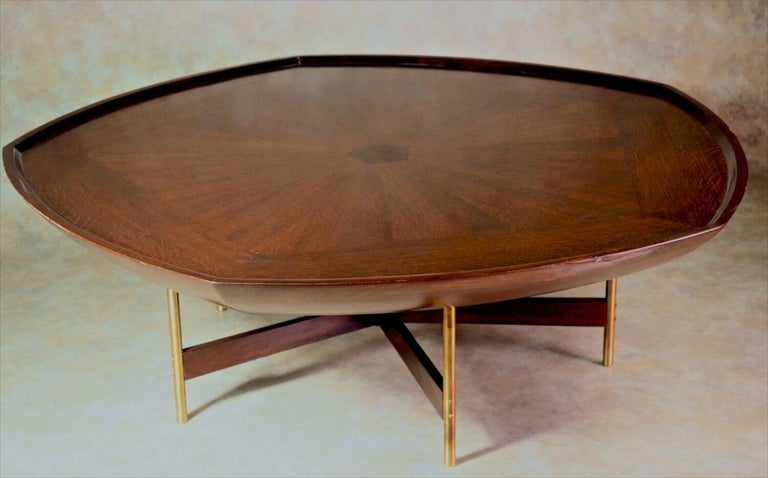 Mid-Century Modern large-scale, pentagon-shaped coffee table designed by Americans Paul Tuttle and Winsor White, circa 1960. This table was a limited edition production piece produced by Baker furniture. This design was showcased in the London home