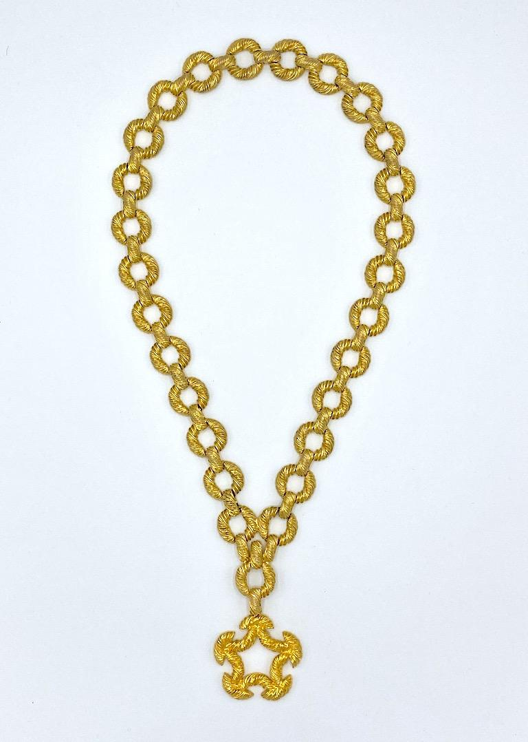 A wonderful 1970s necklace by fashion jewelry designer Pauline Rader. Each strand is comprised of .94 of an inch diameter rope twist ring links .25 of an inch thick. Each ring is connected by .63 of an inch long and .25 of an inch wide bar link.