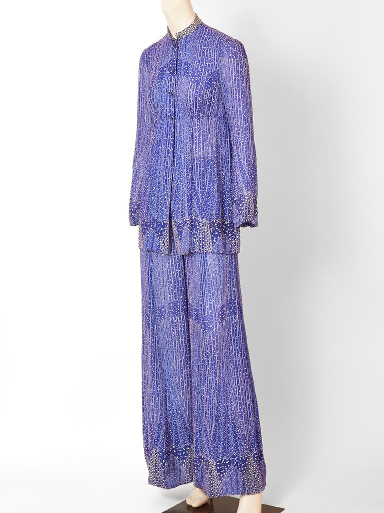Pauline Trigère, layered chiffon, tunic and pant ensemble in a celestial blue tone.  Ensemble has a delicate geometric pattern. The tunic has an empire waist, a rhinestone embellished, mandarin collar, with a sprinkling of rhinestones towards the