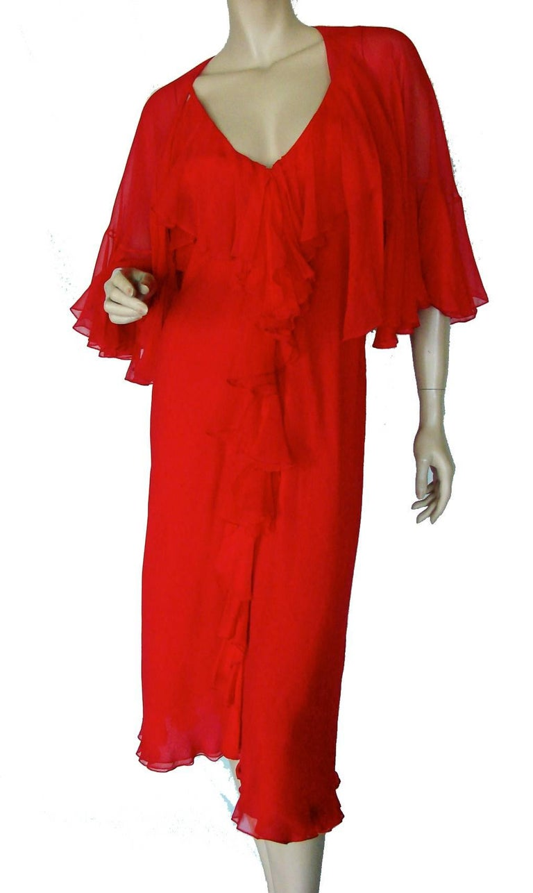 This incredible silk dress with shawl was designed by Pauline Trigere in the late 60s or early 70s.  Made from layers of silk chiffon fabric, the neckline features cascading silk ruffles that spill down the center to the bottom hem.  The matching