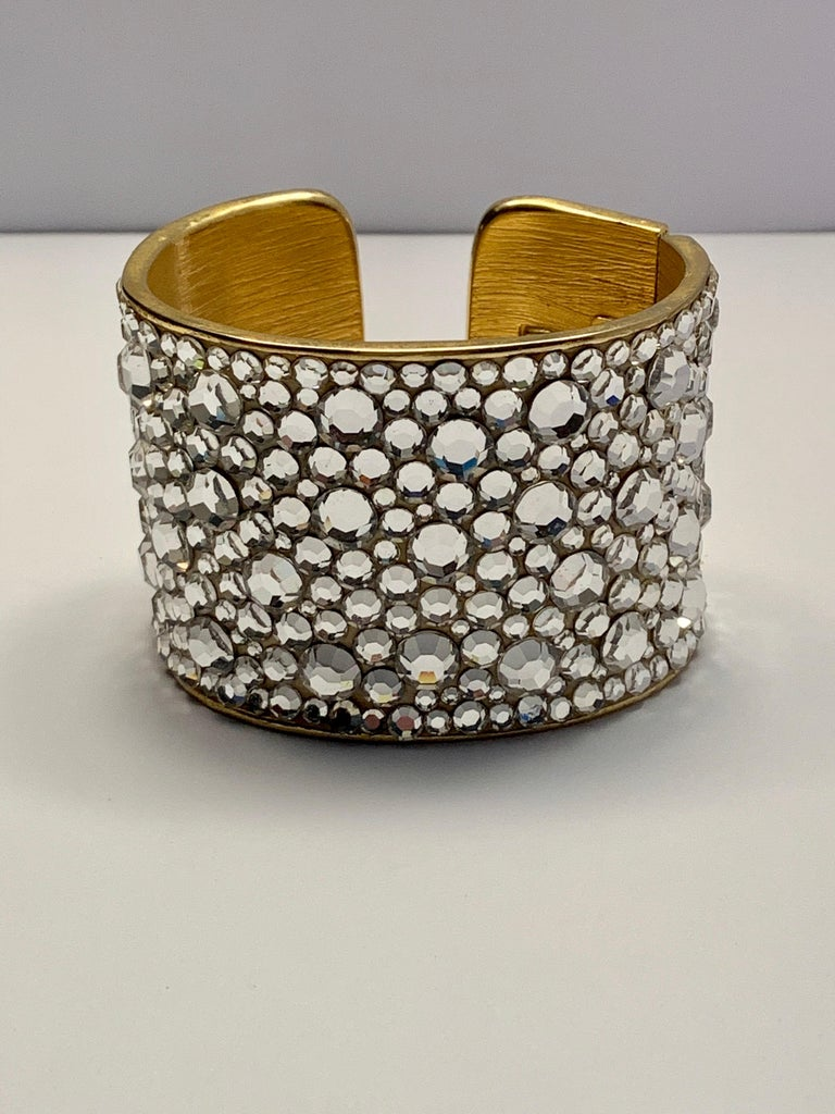Fashion designer Pauline Trigere was a jewelry lover, and she designed and sold fashion jewelry as well as fine jewelry. This stunning cuff is from her fashion jewelry line. It is covered with faceted rhinestones in various sizes. It catches the