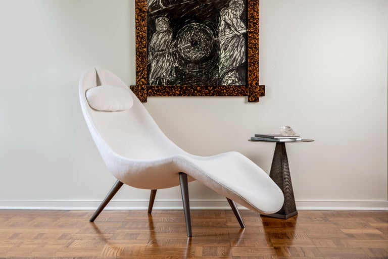 The Pause chaise lounge is handstitched with COM or provided fabric and made with solid brass legs, available in a brushed or polished finish. Meticulously handstitched, the chaise features one continuous seam. Designed to embrace the body, the