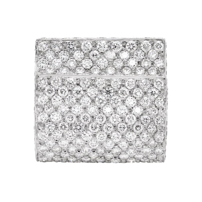 Unique cocktail ring featuring 231 round brilliant cut diamonds, all pavé set in open back settings, totalling to an approximate weight of 3.50ct. What makes this ring unique are the two overlapping layers of white gold meticulously inlaid with