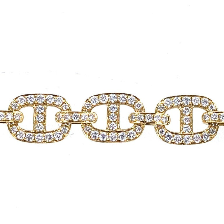 Stylish anchor link diamond bracelet fashioned in 18 karat yellow gold. The links are pave set with 3.65 carat total weight of diamonds graded G-H color and SI clarity. The bracelet measures 7.25 inches in length and 8mm in width.