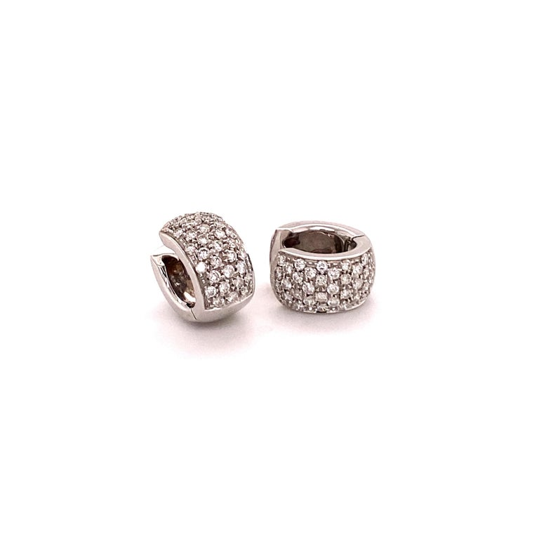 Elegant and classic diamond clip-on earrings crafted in 18K white gold. Two pavé set beds with a total of 70 brilliant-cut diamonds together weighing 0.84 carats . The diamonds are of G/H colour and si clarity.  A must have in every modern jewellery