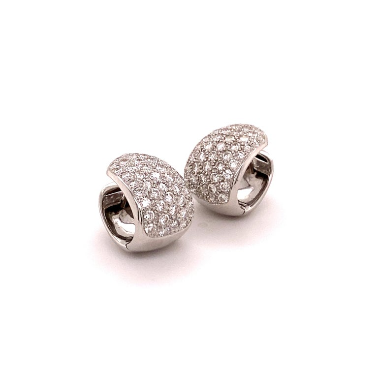Elegant and classic diamond clip-on earrings crafted in 18K white gold. Two pavé set beds with a total of 86 brilliant-cut diamonds together weighing 1.72 carats . The diamonds are of G/H colour and si clarity.  A must have in every modern jewellery