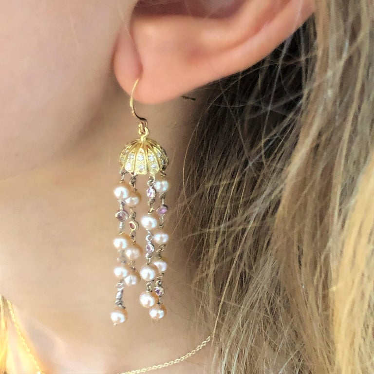 Fourteen karat yellow gold pave diamond rounded flower petal cap hoop earrings Diamond weighing 0.30 carat Freshwater pearl drops with bezel set pink sapphires and diamonds Earrings measuring two inch long New Earrings Handmade in USA