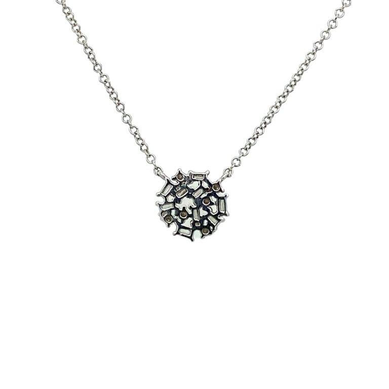 Pavee Diamond Pendant Necklace made with real/natural brilliant cut and baguette diamonds. Diamond Weight: 0.19 carats, Diamond Quantity: 14 diamonds (6 round diamonds/8 Baguettes). Mounted on 14 karat white gold.