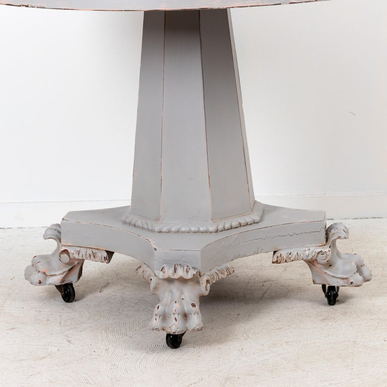 Paw Foot Empire style center or breakfast table on casters. Repainted, distressed finish.
