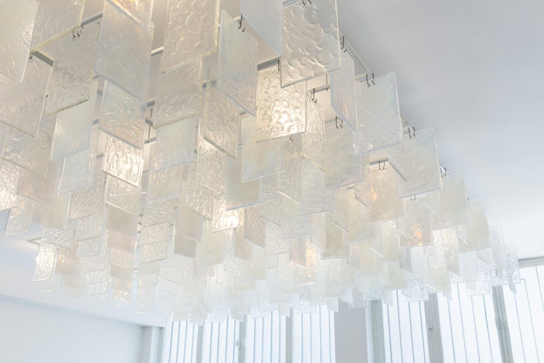 Nine square meters (97 sq ft) hand cast chandelier paysage Opaline and crystal.  Paysage is a monumental glass chandelier born from Hannes Peer's passion for vintage Muranese aesthetics with a contemporary twist and Ermes Glass' need for a piece