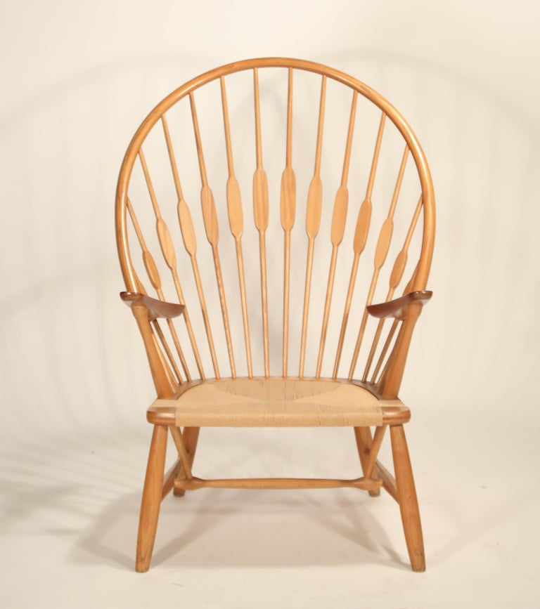 This extremely well-cared-for peacock chair by Hans Wegner came from a single family owner, and while has some minor aging, is in amazing original condition considering its age. Crafted by cabinet maker Johannes Hansen, this Peacock armchair is an