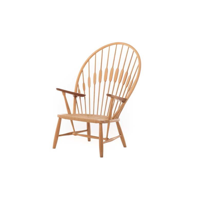 An iconic design by Hans J Wegner, this lounge makes a statement in any environment. In teak and ash with original Danish cord seat. This piece comes with leather seat pad. Seat height is 14