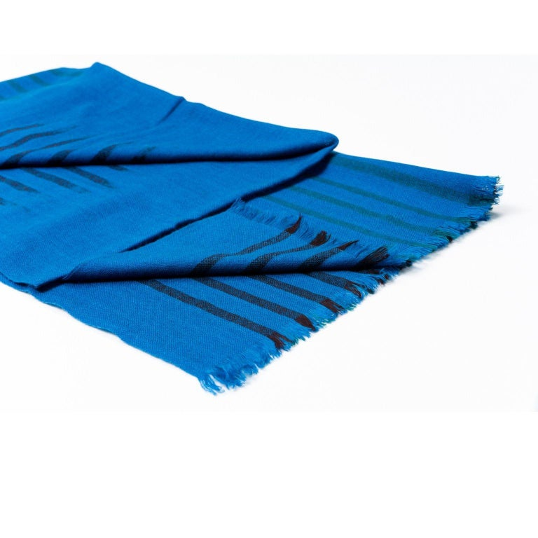 Custom design by Studio Variously, Peacock scarf / wrap / shawl is a handwoven piece using soft merino yarns made by master artisans in Nepal.
