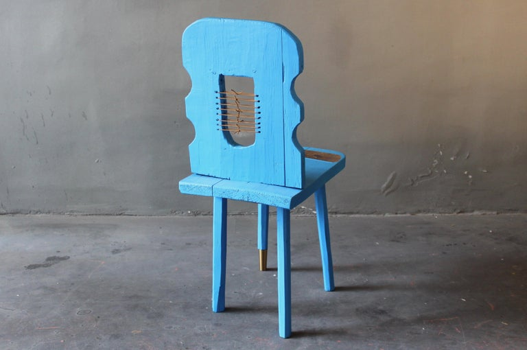 Traditional Austrian Brettlstuhl contemporized. Cut and brought out of shape, painted in strong blue, leather stripes added, lacquered in glossy lacquer. This rustic piece of sculptural design shows the spectrum of Staab work. The original farm