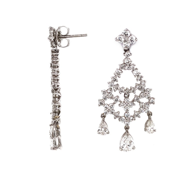 Elegant drop and chandelier mix diamond platinum earrings. High-light diamond stones in pear cut and accented with smaller round diamonds.  All diamonds in total are 5.32 carat.  Diamonds are white and natural and in G-H Color Clarity VS. Platinum