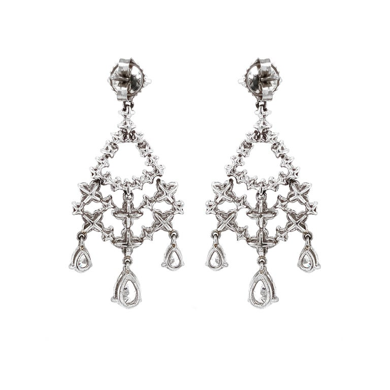 Contemporary Pear Cut and Round Diamonds 5.32 Carat Platinum Earrings For Sale