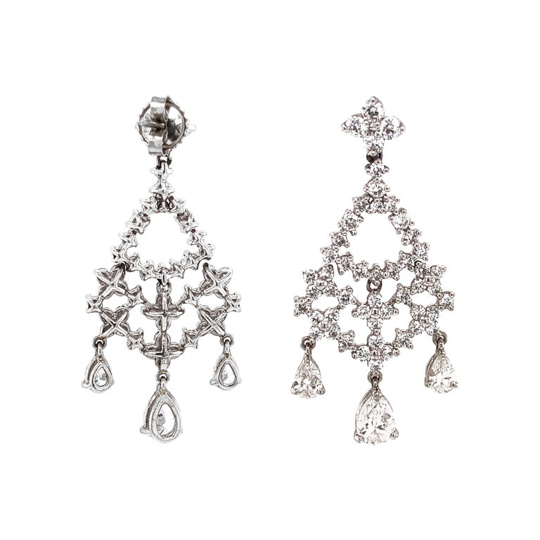 Pear Cut and Round Diamonds 5.32 Carat Platinum Earrings For Sale