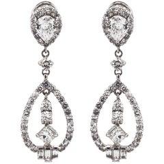 Pear Cut Center Diamond 1.20 Carat Dangling Platinum Earrings