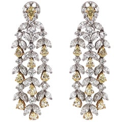 Pear Cut Fancy Yellow Diamonds 6.90 Carat Chandelier Platinum Earrings