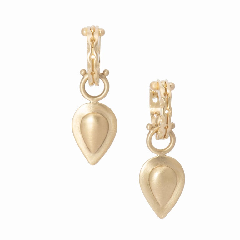 This flattering teardrop shape makes a simple, stylish statement in luscious 18k gold. The repousse design in our satin finished 18k gold is hand crafted in our studio and the result is a light weight, 3-dimensional Pear Drop, beaded on the bail and