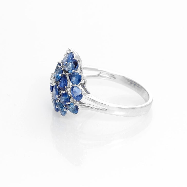 Pear Sapphire and Diamond 14K White Gold Ring Size 8 - Cluster Sapphire ring with 4.48 cts. A few hints of diamond peek from within the bouquet of blue stones. Crafted in 14K white gold with 0.07 carats of diamond accent. Size 8 but can be sized.
