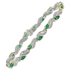 Pear Shape 5.0 Carat Colombian Emerald and Baguette Diamond White Gold Bracelet